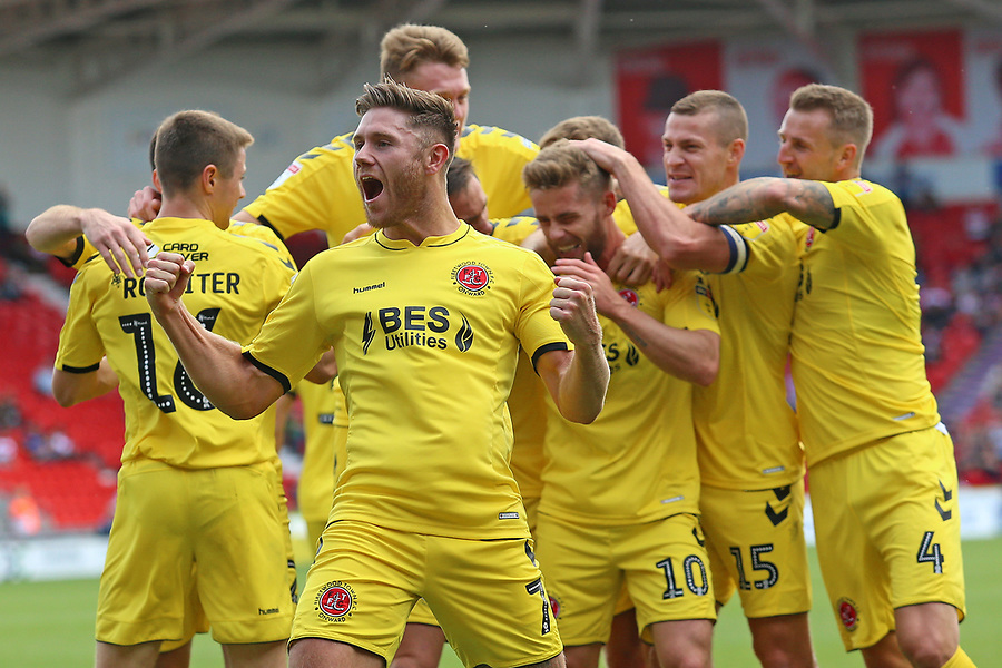 Fleetwood Town's Conor McAleny (10) is mobbed after scoring the opening goal<br /> <br /> Photographer David Shipman/CameraSport<br /> <br /> The EFL Sky Bet League One - Doncaster Rovers v Fleetwood Town - Saturday 17th August 2019  - Keepmoat Stadium - Doncaster<br /> <br /> World Copyright © 2019 CameraSport. All rights reserved. 43 Linden Ave. Countesthorpe. Leicester. England. LE8 5PG - Tel: +44 (0) 116 277 4147 - admin@camerasport.com - www.camerasport.com