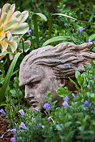 Stone sculpture of mythical god in Diana Magor Garden