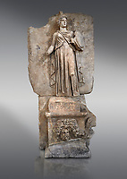 """Roman Sebasteion relief sculpture personifing a Balkan Warrior  Aphrodisias Museum, Aphrodisias, Turkey.  Against a grey background.<br /> <br /> The relief figure personifies a Balkan Warrior tribe defeated by Tiberius in AD 6-8 before he became emperor. She wears a classical dress, cloak and helmet and carries a small shield and probably once a spear. A builder's inscription, """"Pirouston"""", written above the shield, ensured the relief was put on the right base"""