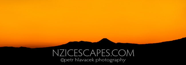 Silhouetted Mount Ngaruhoe at dawn, Tongariro National Park, Central Plateau, North Island, UNESCO World Heritage Area, New Zealand, NZ