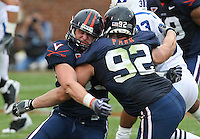 Virginia players run into each other during an ACC football game against Duke Saturday in Charlottesville, VA. Duke won 28-17. Photo/Andrew Shurtleff