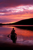 canoeing, canoe, sunrise, sunset, Vermont, VT, A woman paddles a canoe on Kettle Pond at sunset in Groton State Forest.