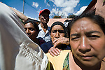 Residents of  San Jose El Recreo, San Marcos, where one of the hardest hit by a 7.4 earthquake struck Guatemala Wednesday Nov. 7. gather to wait emergency food aid.