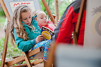 Thursday  29 May 2014, Hay on Wye, UK<br /> Pictured: Young Girls relax and read at the Hay festival <br /> Re: The Hay Festival, Hay on Wye, Powys, Wales UK.