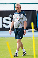 England manager Roy Hodgson sticks his tongue out during training