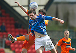 St Johnstone v Dundee Utd....21.04.12   SPL.Cillian Sheridan and Gavin Gunning.Picture by Graeme Hart..Copyright Perthshire Picture Agency.Tel: 01738 623350  Mobile: 07990 594431