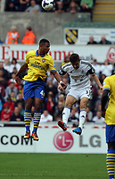 Saturday 28 September 2013<br /> Pictured: Ben Davies of Swansea (R) battling for a header against Serge Gnabry of Arsenal (L)<br /> Re: Barclay's Premier League, Swansea City FC v Arsenal at the Liberty Stadium, south Wales.
