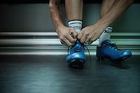 Christian Meier (CAN/Orica-GreenEDGE) getting his shoes on ahead of the race<br /> <br /> 2014 Tour de France<br /> stage 18: Pau - Hautacam (145km)