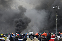 Thick clouds of smoke raises high from the battlefield during the   protest against new draconian law to ban the right to  protest across the country.  Kiev. Ukraine