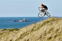 Clinton Johns riding a DMR mountain bike . Gwithian , Cornwall. July 2015