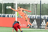 FOXBOROUGH, MA - OCTOBER 19: Matt Turner #30 of New England Revolution dives to deflect a shot at goal during a game between Philadelphia Union and New England Revolution at Gillette on October 19, 2020 in Foxborough, Massachusetts.
