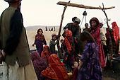 Khogebha Hoddin, Afghanistan October 2001<br /> <br /> At a watering hole in the Nawabad refugee camp.
