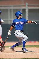 Texas Rangers Miguel Aparicio (86) during an Instructional League game against the Cincinnati Reds on October 4, 2016 at the Surprise Stadium Complex in Surprise, Arizona.  (Mike Janes/Four Seam Images)