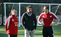Pictured L-R: Nigel Rees, men's squad coach Pep and Dave Adams, head of academy coaching. Wednesday 14 May 2014<br /> Re: Swansea City FC academy has invited local football coaches to show them coaching techniques at the club's Landore training ground.