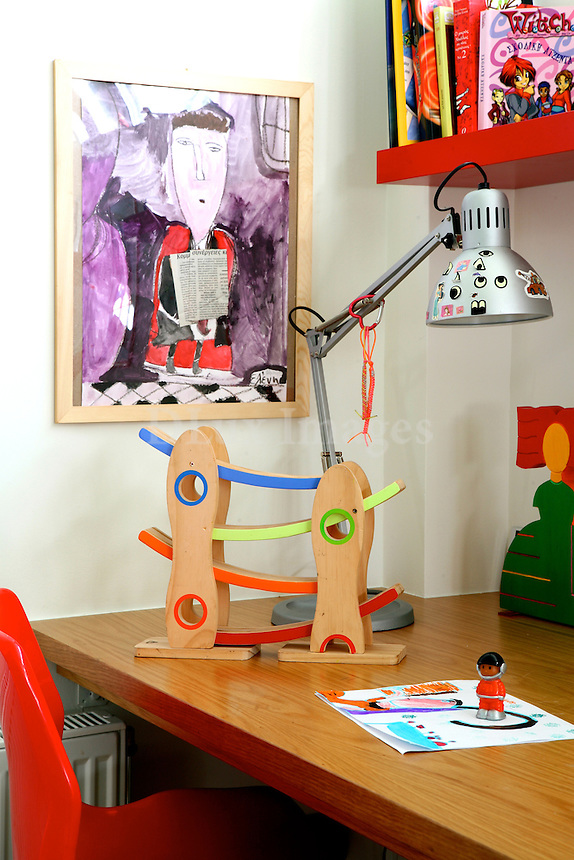Architect and interior designer, Eddy Robert, designs the furniture of his own projects as he did here for his family house in the center of Athens.
