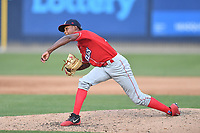 Lakewood BlueClaws pitcher Manuel Silva (14) delivers a pitch during a game against the Asheville Tourists at McCormick Field on June 15, 2019 in Asheville, North Carolina. The BlueClaws defeated the Tourists 4-2. (Tony Farlow/Four Seam Images)