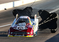 Mar 28, 2014; Las Vegas, NV, USA; NHRA funny car driver Tim Wilkerson has a blower explosion during qualifying for the Summitracing.com Nationals at The Strip at Las Vegas Motor Speedway. Mandatory Credit: Mark J. Rebilas-