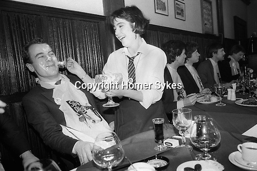 School Dinners. Lunch time private members club in the City of London. Members got fed typical public ie private school dinners by scantily clad St Trinians style waitresses. 1980s