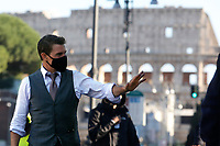 Actor Tom Cruise greeting his fans and in the background the Coliseum, on the set of the film Mission Impossible 7 at Imperial Fora in Rome. <br /> Rome (Italy), November 21st 2020<br /> Photo Samantha Zucchi Insidefoto