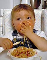 Learning to eat. Baby eating. Douglaston NY.
