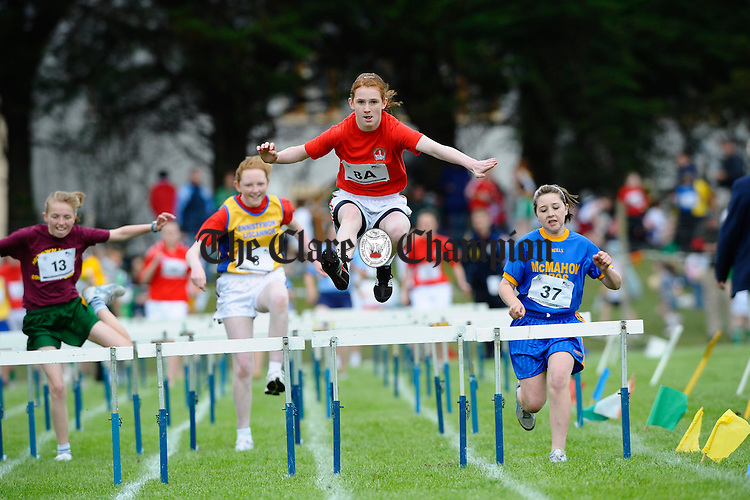 Gemma Mc Evoy, Quin Clooney, is first over her hurdle at the Clare Community Games Athletics finals in Rosslevan. Photograph by John Kelly.