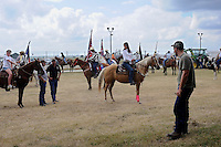 USA. Angola. 12th October 2008..Prisoners on horseback and other contestants gather outside the Rodeo entrance..©Andrew Testa/Panos