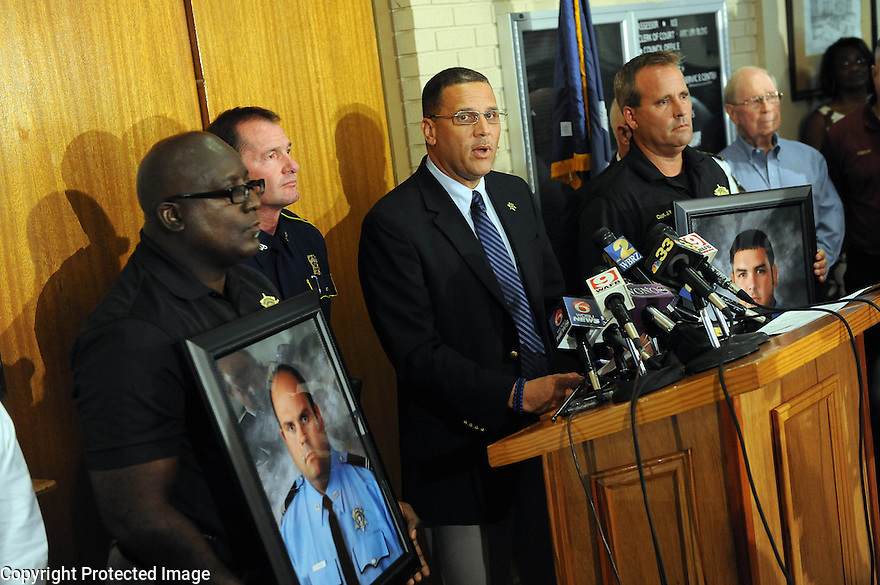 St. John the Baptist Parish Sheriff Mike Tegre speaks at a press conference after an early morning shooting at a Steel plant parking lot left two police officers dead and at least two civilians injured in Laplace, Louisiana August 16, 2012.  REUTERS/Cheryl Gerber  (UNITED STATES)