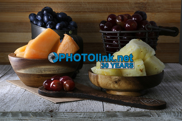 Wooden spoon and fruits<br /> Photo By Adam Scull/PHOTOlink.net