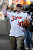Clemson University President Jim Clements warms up his arm before throwing out the first pitch at the Reedy River Rivalry game on March 1, 2014, at Fluor Field at the West End in Greenville, South Carolina. South Carolina won, 10-2. (Tom Priddy/Four Seam Images)
