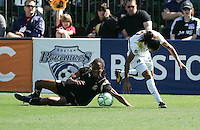 Kandace Wilson (left) falls battling for the ball against Marta (right). Los Angeles Sol defeated FC Gold Pride 2-0 at Buck Shaw Stadium in Santa Clara, California on May 24, 2009.