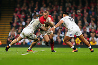 Pictured: Hadleigh Parkes of Wales is tackled by Tom Curry of England during the Guinness six nations match between Wales and England at the Principality Stadium, Cardiff, Wales, UK.<br /> Saturday 23 February 2019