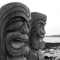Black-and-white portrait of ancient Polynesian-style wooden Tiki carvings in Ki'i Pu'uhonua O Honaunau National Park on the Big Island of Hawaii