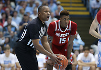 CHAPEL HILL, NC - FEBRUARY 25: Official Michael Stephens holds the ball during a game between NC State and North Carolina at Dean E. Smith Center on February 25, 2020 in Chapel Hill, North Carolina.