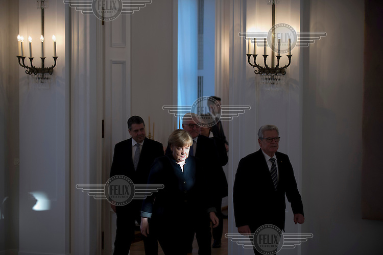 Chancellor Angela Merkel and other leading politicians at a ceremony at Schloss Bellevue palace.