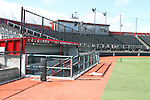 A view of the visitor's dugout and the press box at Bailey-Brayton Field (with the bubble of the IPF in the background), the baseball home of the Washington State Cougar baseball teams, on the campus of Washington State University in Pullman, Washington.