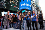 Coinbase Global Inc. employees spray champagne during the company's initial public offering (IPO) outside of the Nasdaq MarketSite in New York, U.S., on Wednesday, April 14, 2021. Photograph by Michael Nagle