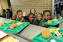 Students at New Orleans College Prep School enjoy a cooked meal prepared by Liberty Kitchen, a training program for at-risk youths, in New Orleans, Thurs., March 22, 2012.