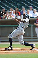 Lorenzo Cain CenterFielder Huntsville Stars (Milwaukee Brewers) swings at a pitch during the Southern League Playoffs at Smokies Park in Sevierville, TN September 13, 2009 (Photo by Tony Farlow/ Four Seam Images)