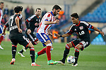 Atletico de Madrid's Raul Garcia (c) and Bayer 04 Leverkusen's Son Heung-Min (l) and Wendell during Champions League 2014/2015 match.March 16,2015. (ALTERPHOTOS/Acero)