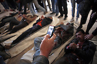 SYRIA, 02.2012, Idlib, Idlib province. © Timo Vogt/EST&OST. Seven bodies of executed men are placed on the floor of a mosque. The men were apparently totured before they were shot dead.