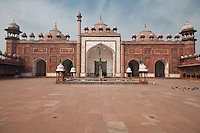 Agra, India.  Courtyard of the Jama Masjid, the Friday Mosque, built 1648.  Chhatris line the roof.  The minaret to the right of the entrance collapsed in 1970.