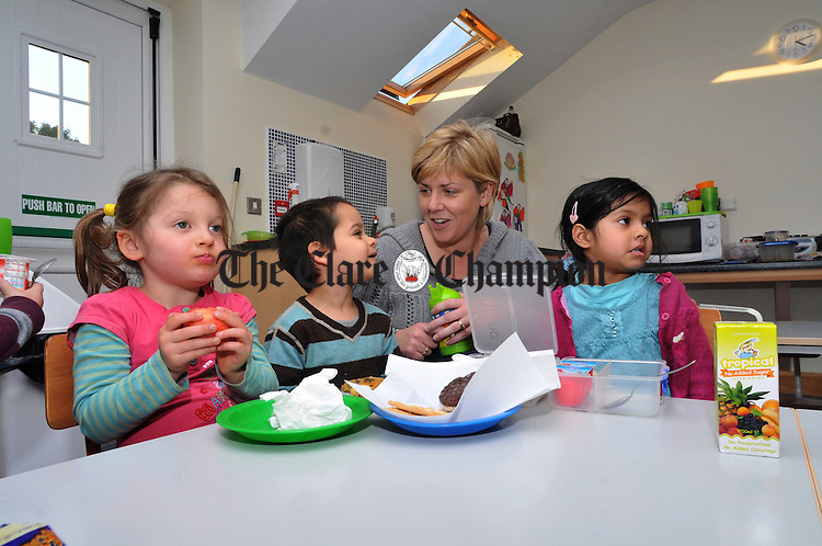 Clare Tuohy pictured with some of the children at the Lifford Childcare Centre. Photograph by Declan Monaghan
