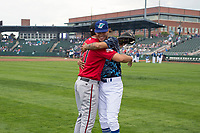 Billings Mustangs catcher Pabel Manzanero (47) and Ogden Raptors starting pitcher Jose Chacin (26) say hello to one another before a Pioneer League game against the Ogden Raptors at Lindquist Field on August 17, 2018 in Ogden, Utah. The Billings Mustangs defeated the Ogden Raptors by a score of 6-3. (Zachary Lucy/Four Seam Images)