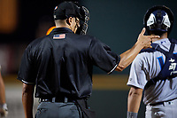 Home plate umpire Robert Nunez calls a strike behind catcher Francisco Diaz (17) during a game between the Tampa Tarpons and the Bradenton Marauders on April 25, 2018 at LECOM Park in Bradenton, Florida.  Tampa defeated Bradenton 7-3.  (Mike Janes/Four Seam Images)