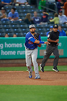 Edwin Rios (24) of the Oklahoma City Dodgers throws to first base against the Salt Lake Bees at Smith's Ballpark on July 31, 2019 in Salt Lake City, Utah. The Dodgers defeated the Bees 5-3. (Stephen Smith/Four Seam Images)