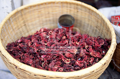 The Gambia. Market place; basket of hibiscus flowers, for hibiscus tea.