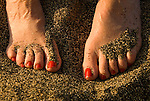 Feet in beach sand