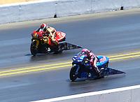 Jul. 27, 2014; Sonoma, CA, USA; NHRA pro stock motorcycle rider Angie Smith (near lane) races alongside Chaz Kennedy during the Sonoma Nationals at Sonoma Raceway. Mandatory Credit: Mark J. Rebilas-