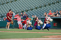 Frisco RoughRiders on field promotion race in between innings during a Texas League game against the Springfield Cardinals on May 6, 2019 at Dr Pepper Ballpark in Frisco, Texas.  (Mike Augustin/Four Seam Images)