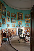A private dining room hung with paintings collected on the Grand Tour. A portrait of Louise de Keroualle, mother of the first duke of Richmond, hangs above the mantelpiece